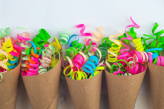 Brown paper cones filled with colourful party ribbons