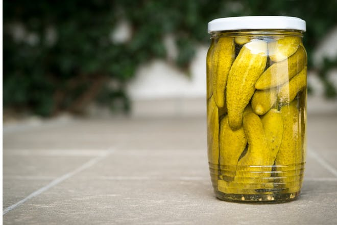 pickled gherkins in a jar