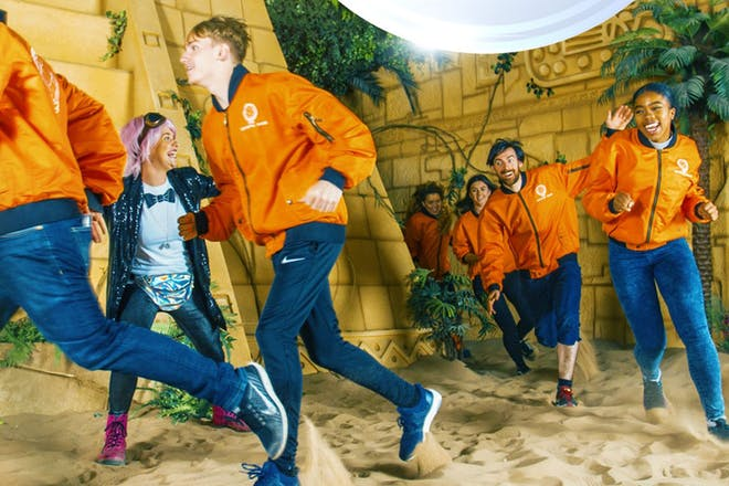 People running in Aztec zone at Crystal Maze experience
