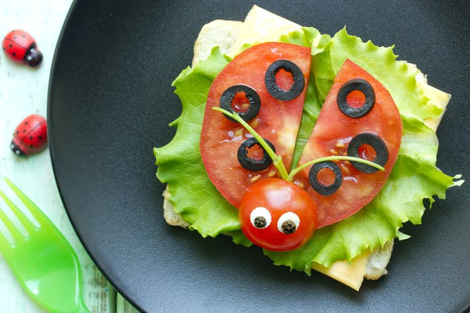 Cheese and tomato sandwich in ladybird shape