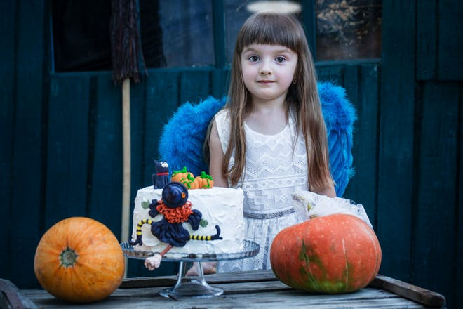 A girl dressed as an angel on Halloween