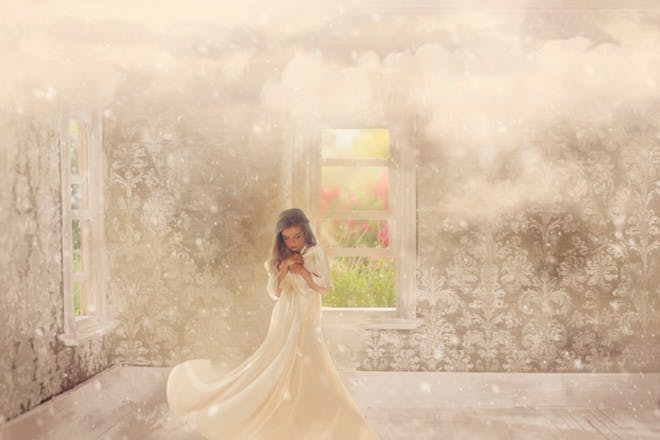 girl in white dress with clouds above her
