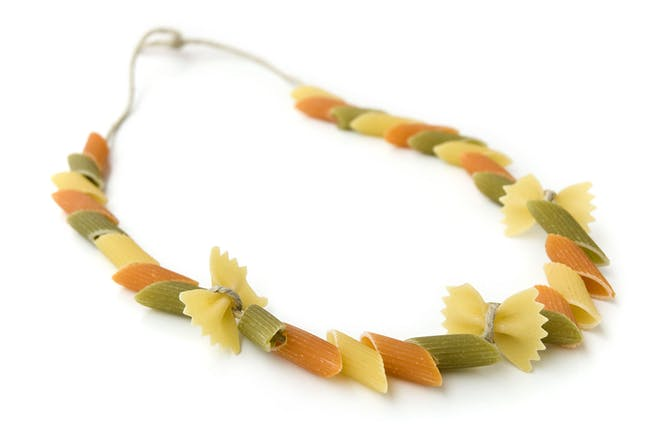 pasta shapes threaded on string to make necklace