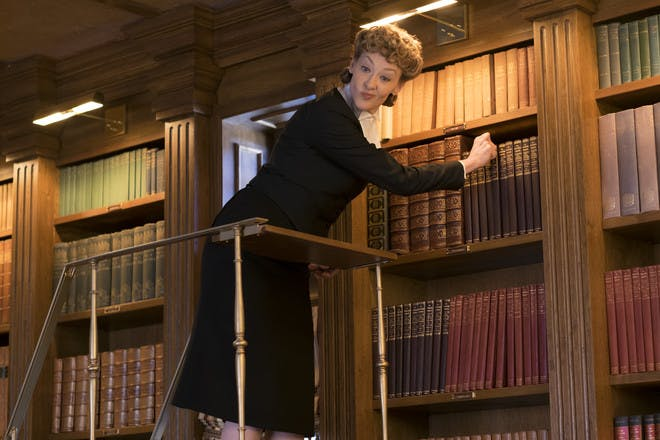 production still from Netflix A Series of Unfortunate Events - Justice Strauss up a ladder