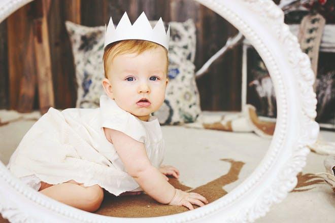 baby wearing crown