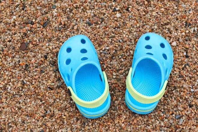blue crocs on beach