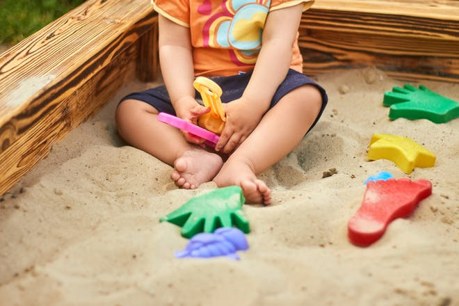 child in sand pit