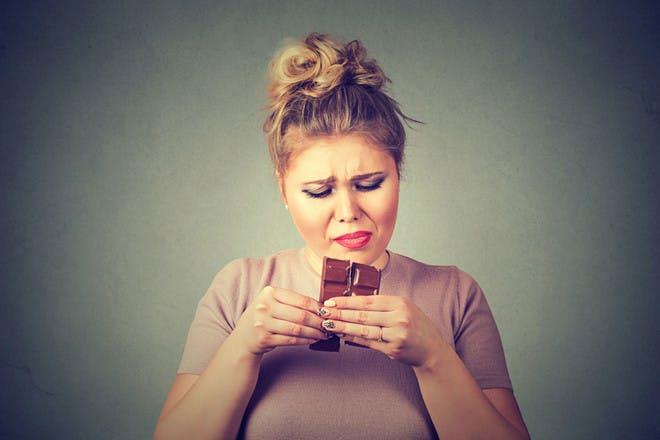 Lady eating chocolate