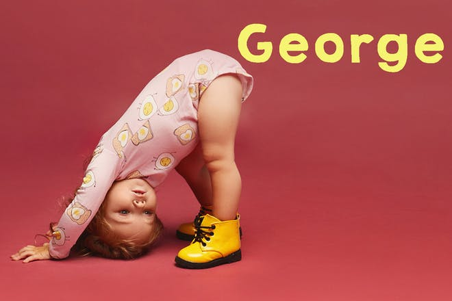 Baby wearing yellow DMs, bending over. Text says George
