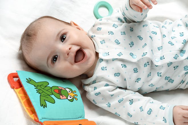 baby laughing in cot