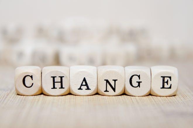 Change written on wooden cubes