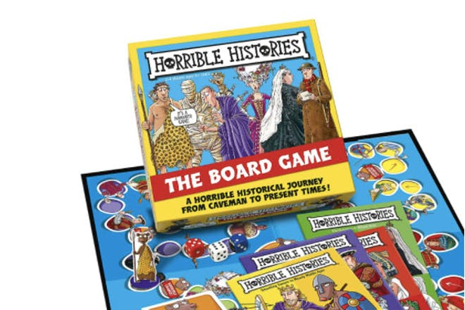 Horrible Histories the board game box resting on playing board