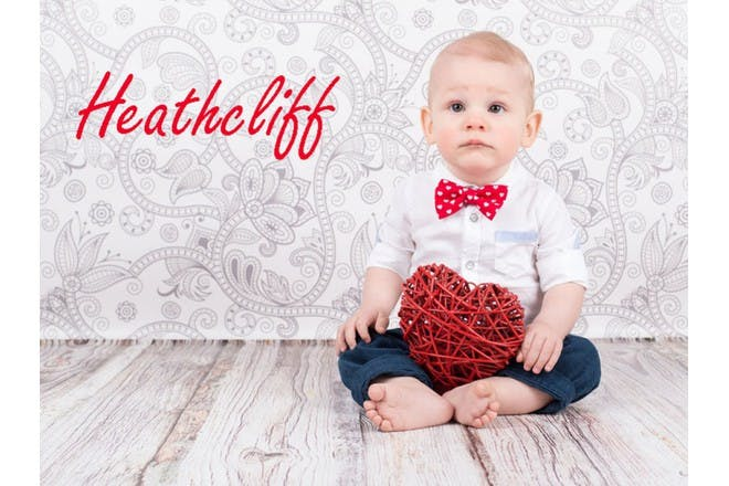 baby boy with red heart prop
