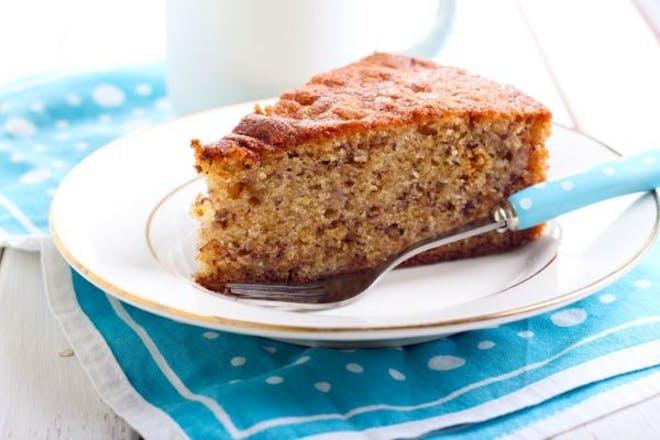 plate with slice of banana cake and fork