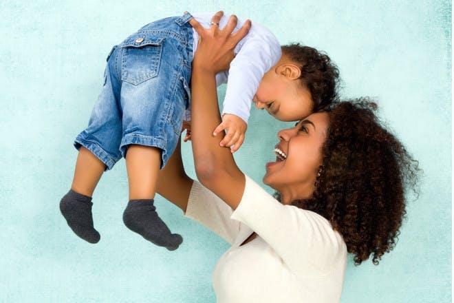 Mum holding son in air