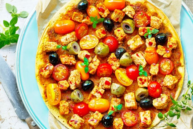 pancake covered in tomatoes, olives and quorn chunks
