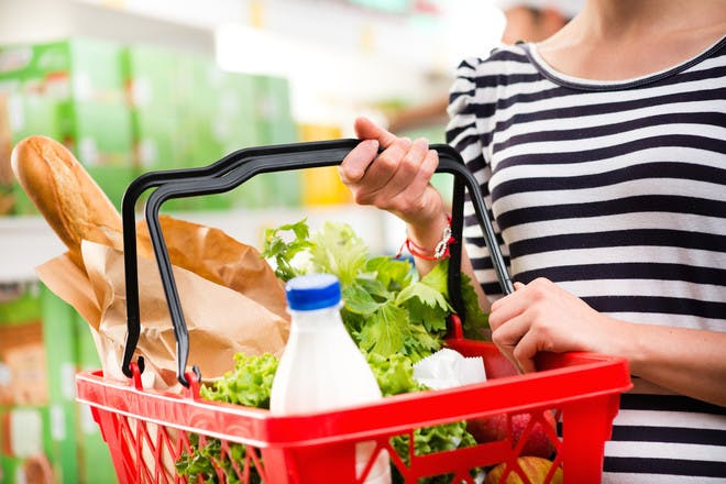 Woman with full shopping basket