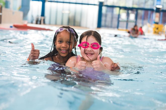 Two girls swimming at Swallows leisure centre