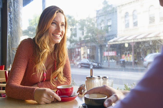 woman having coffee in cafe