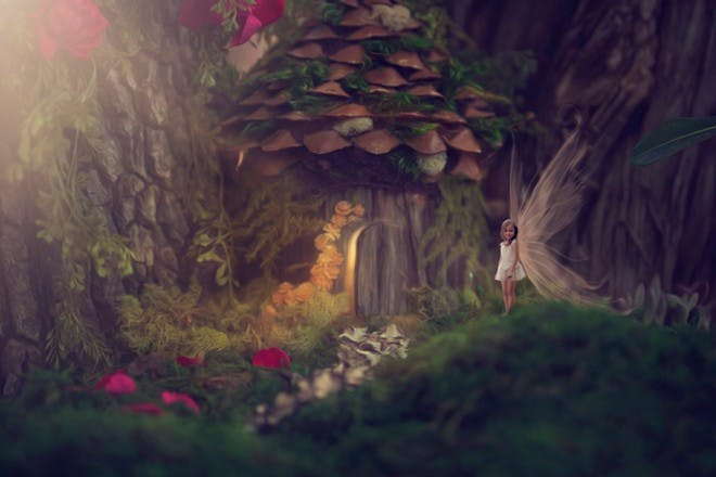small girl fairy outside fairy house
