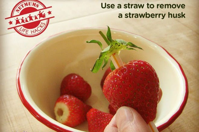 strawberries in bowl with husks removed