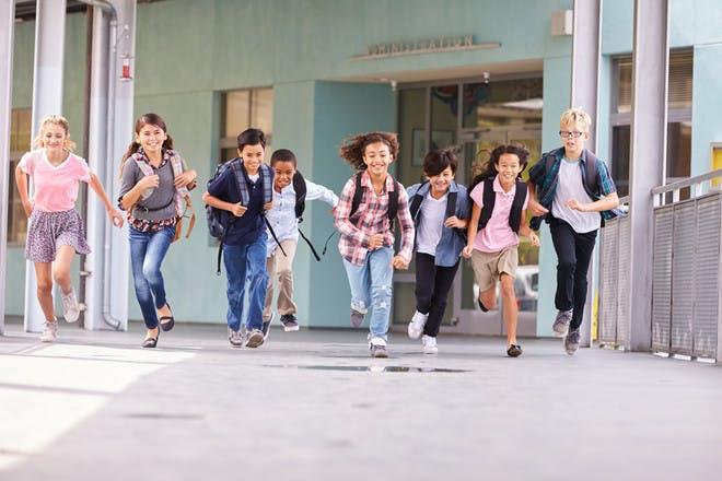 Kids running from school at start of summer holidays