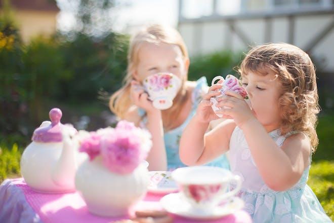 Two little girls having tea party