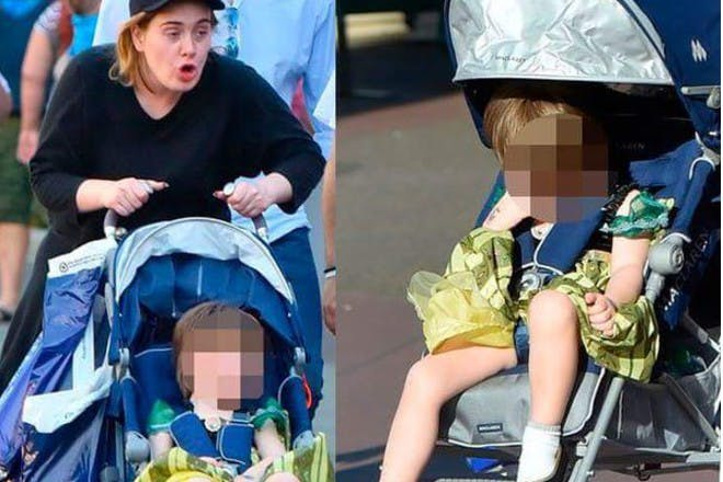 adele pushing son in buggy