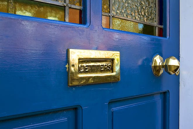 Close up of blue front door with letter box