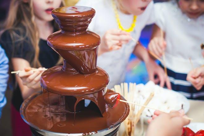 Kids enjoying a chocolate fondue