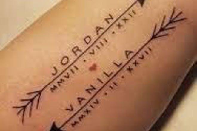 Arrow name tattoo