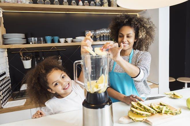 Child and mum making smoothie