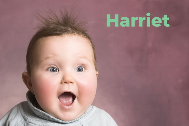 Surprised looking baby. Name Harriet written in text