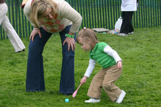 Child rolling an egg