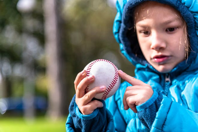 Child with autism looking at ball