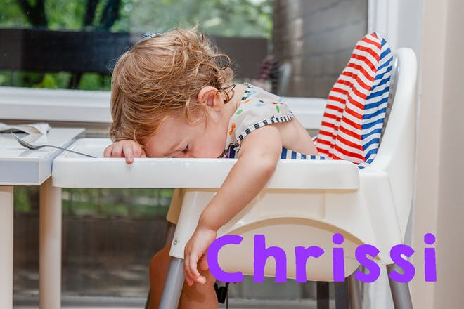 Baby asleep on tray of highchair. Text says Chrissi