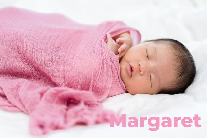 Baby wrapped in pink swaddle cloth name Margaret written in text