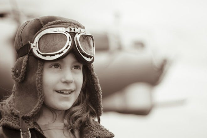 girl wearing vintage pilot goggles and trapper hat