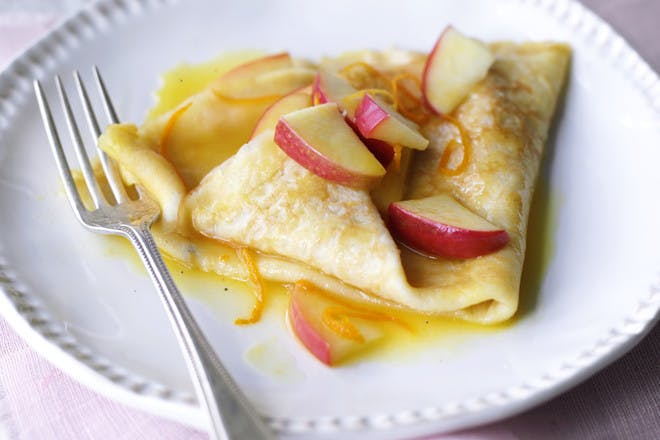 Pancakes with buttery apple sauce recipe. French Crepes Suzette with apples.