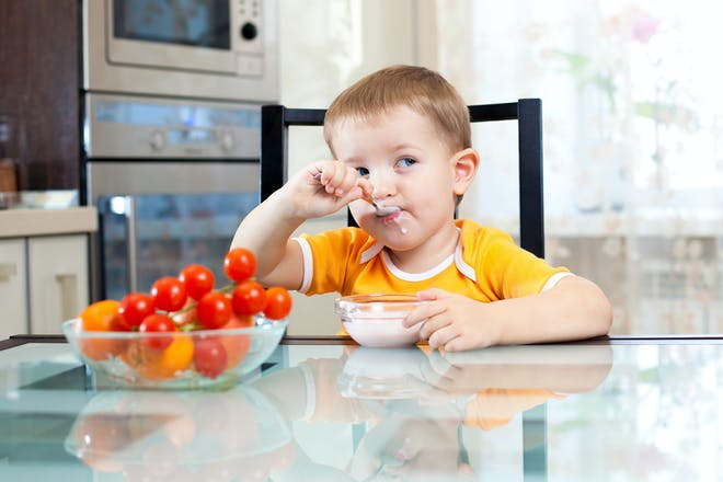 Child eating at kitchen table