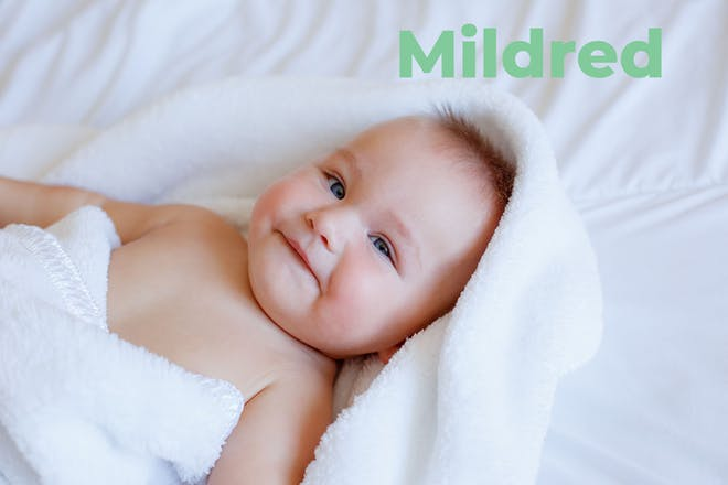 Baby wrapped in towel. Name Mildred written in text