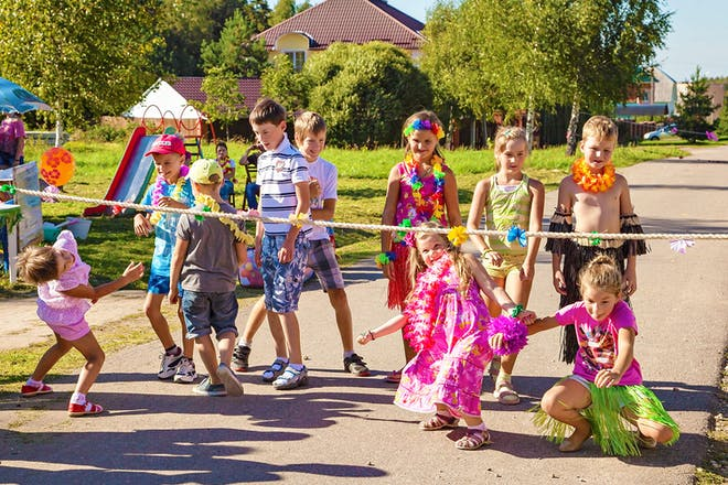 kids limbo dancing in colourful costumes