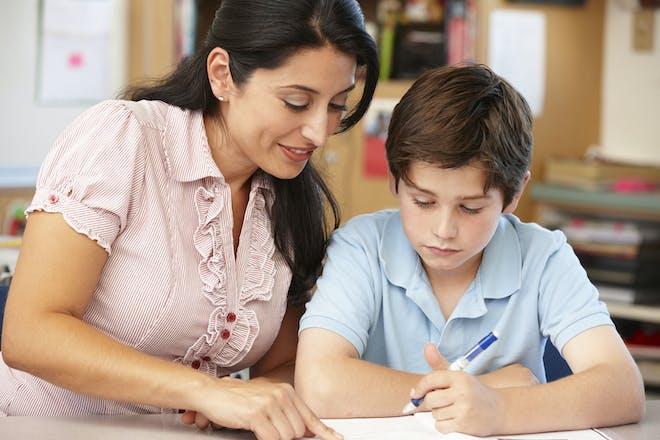 Mum homeschooling boy