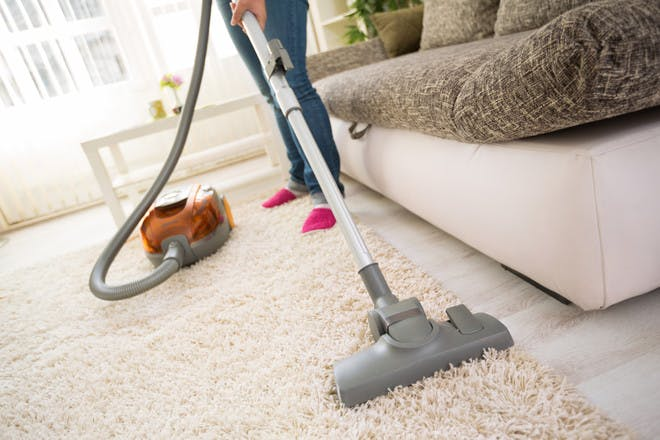 Person hoovering living room