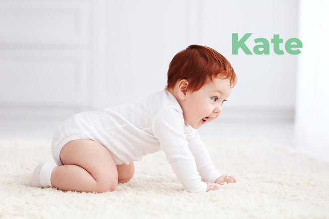 Baby on all fours. Name Kate written in text