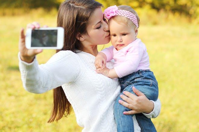 Mum taking selfie with baby