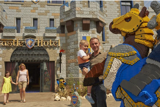 Family outside Legoland Castle Hotel with Lego Knight on horse