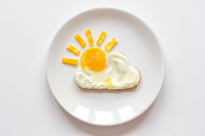 Fried egg that looks like a cloud with the yolk as a sun