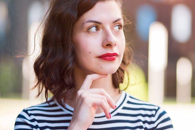 woman thinking wearing striped shirt
