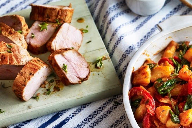 Roast pork with spicy potatoes, spinach and tom
